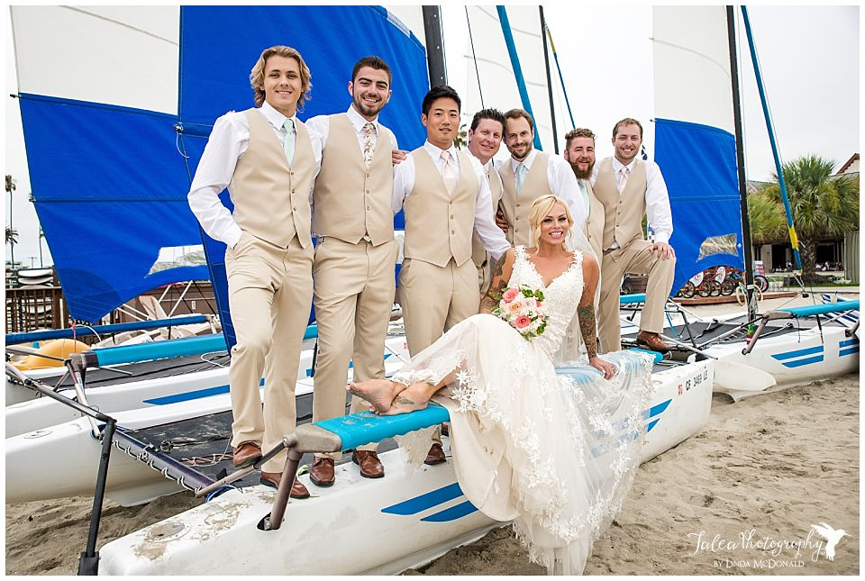 bride-groomsmen-on-sailboard-at-mission-bay-catamaran-san-diego