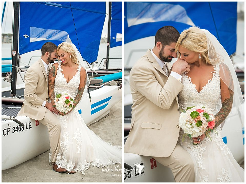 bride-groom-romantic-photo-sitting-on-sailboat-catamaran-resort-san-diego-wedding