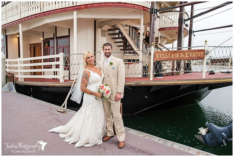 bride-groom-posing-in-front-of-william-d-evans-boat-san-diego