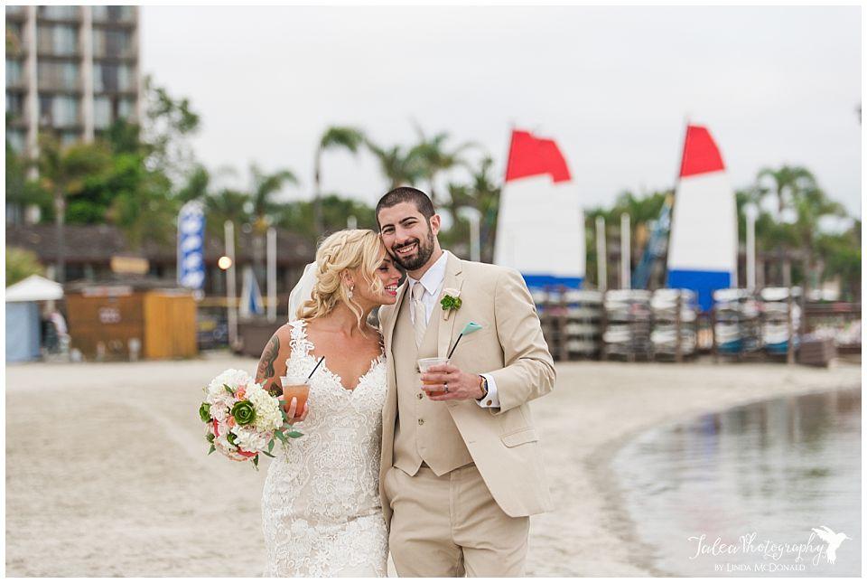 bride-groom-walking-on-mission-bay-in-san-diego