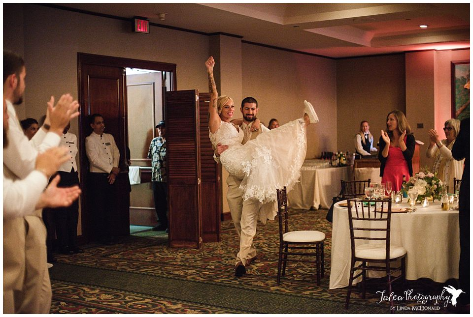 grand-entrance-groom-holding-bride-groom