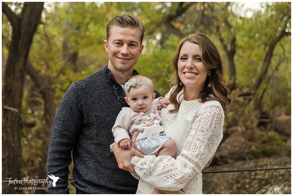family of three posing for portraits in san diego