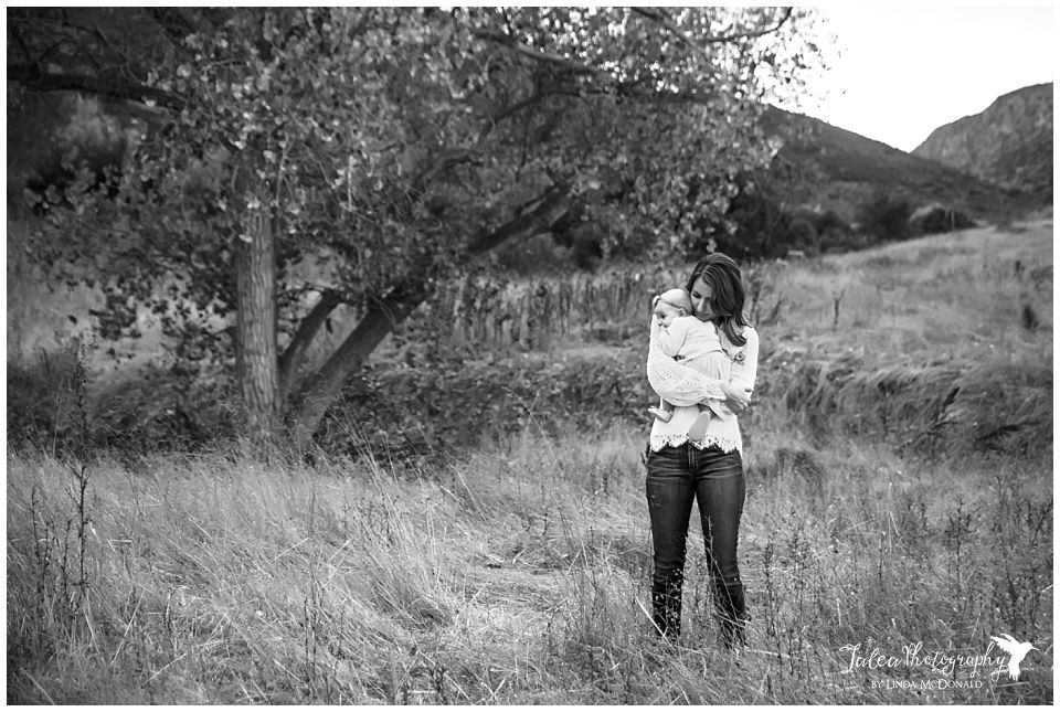 quiet-moment-mama-baby-grassy-field-black-white-image