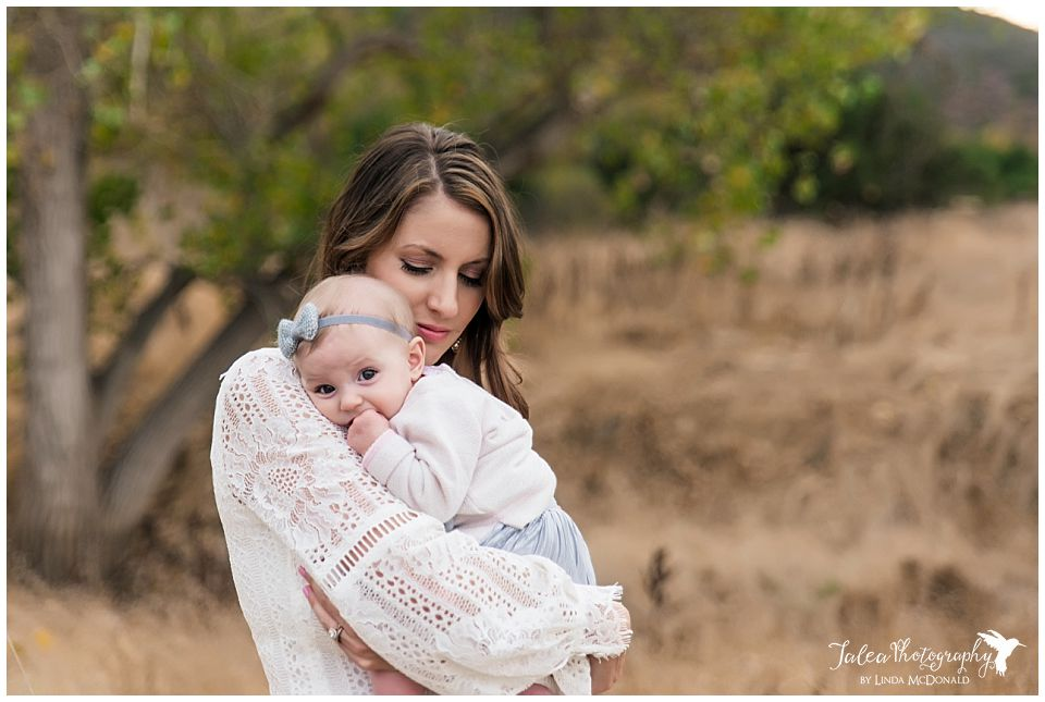 mama-snuggling-baby-in-open-field-san-diego-family-photo-session