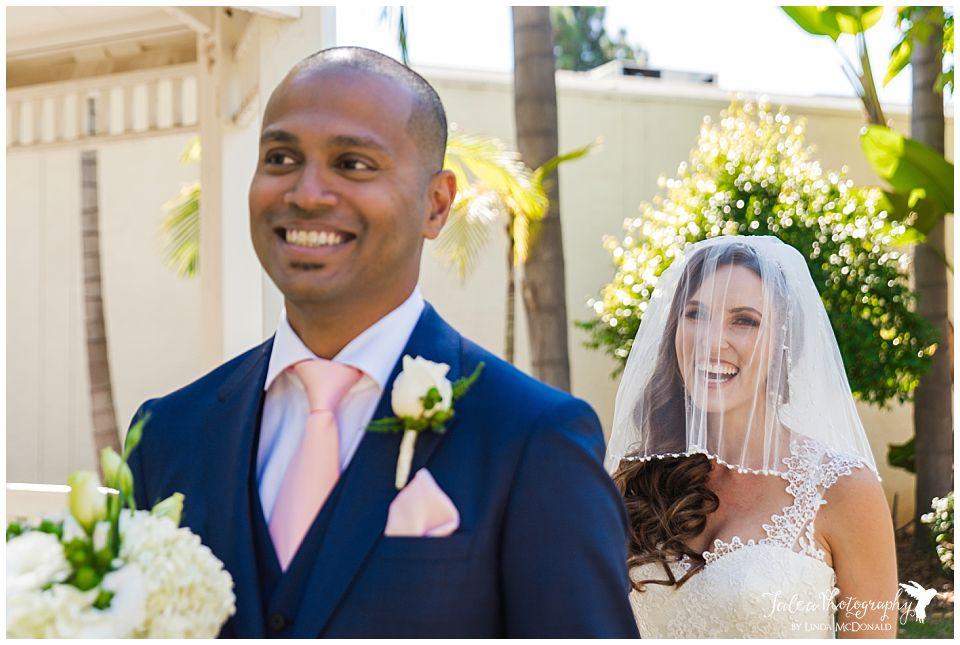bride-approaching-groom-for-first-look-near-gazebo
