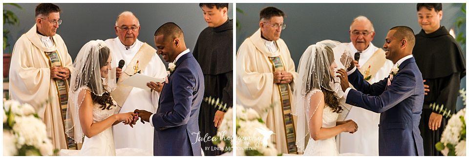 bride-placing-ring-on-grooms-finger-groom-removing-veil