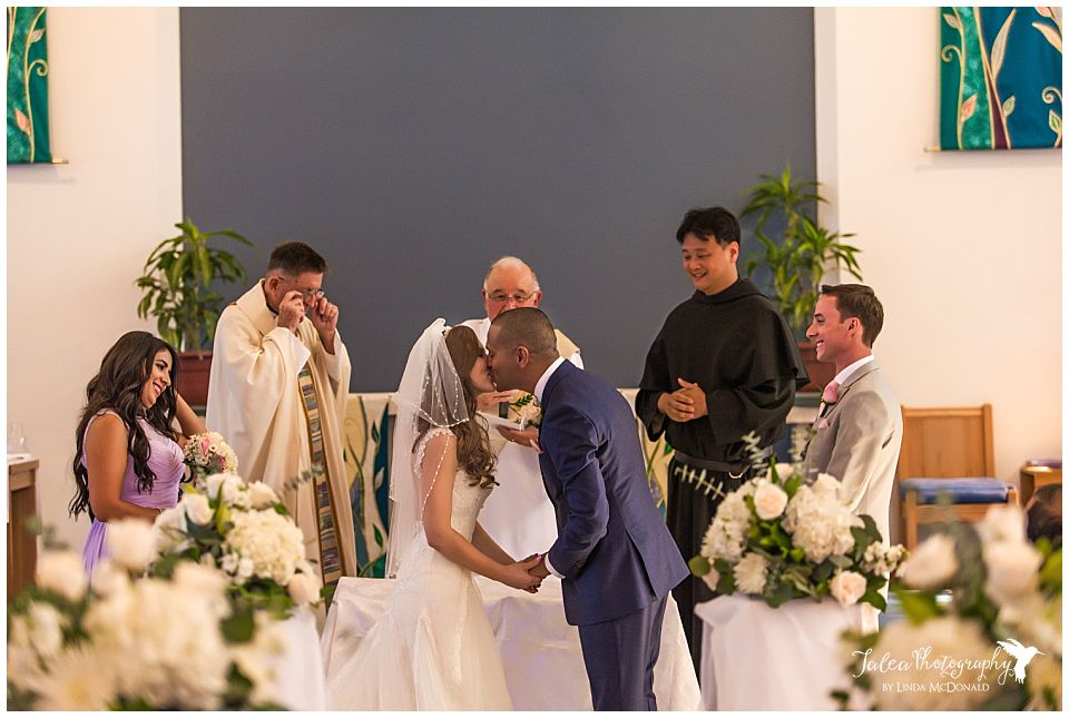wide-angle-view-of-bride-groom-first-kiss