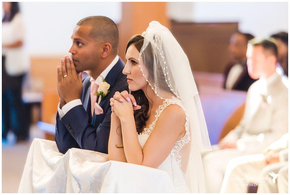 bride-groom-praying-catholic-church-ceremony