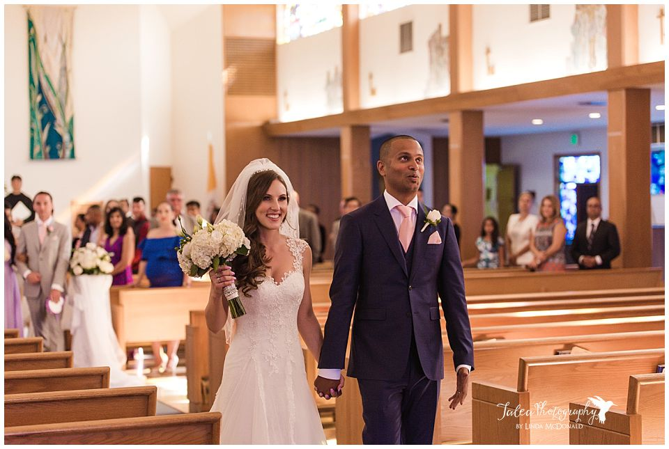 groom-looking-relieved-after-ceremony-during-recessional