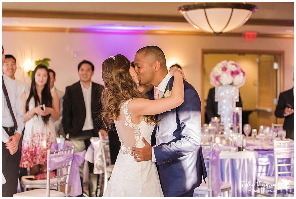 bride-groom-kissing-before-first-dance-hilton-san-diego-harbor-island-wedding