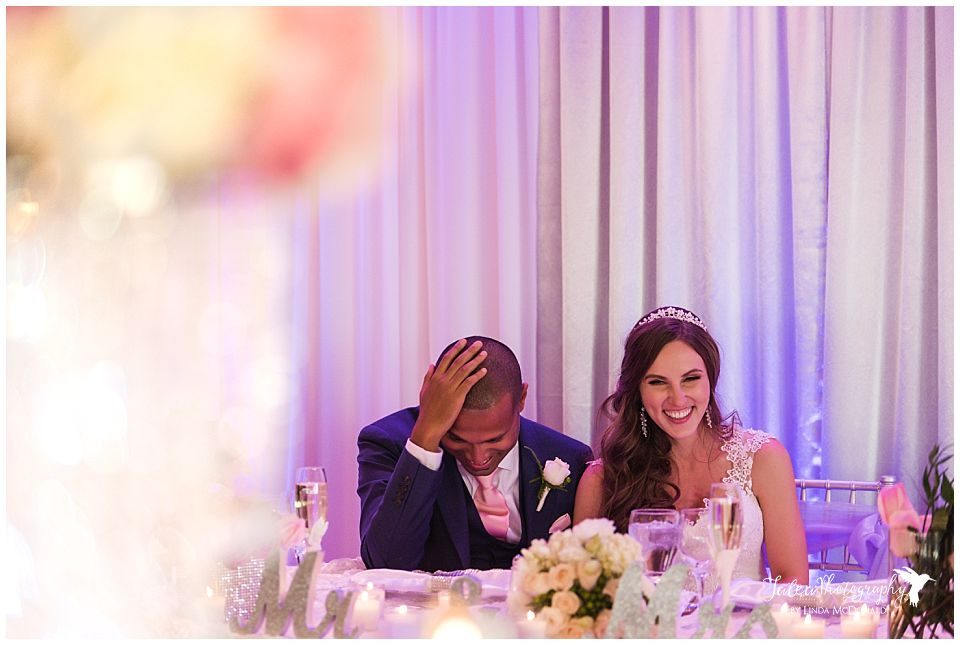 bride-groom-laughing-during-reception-speech