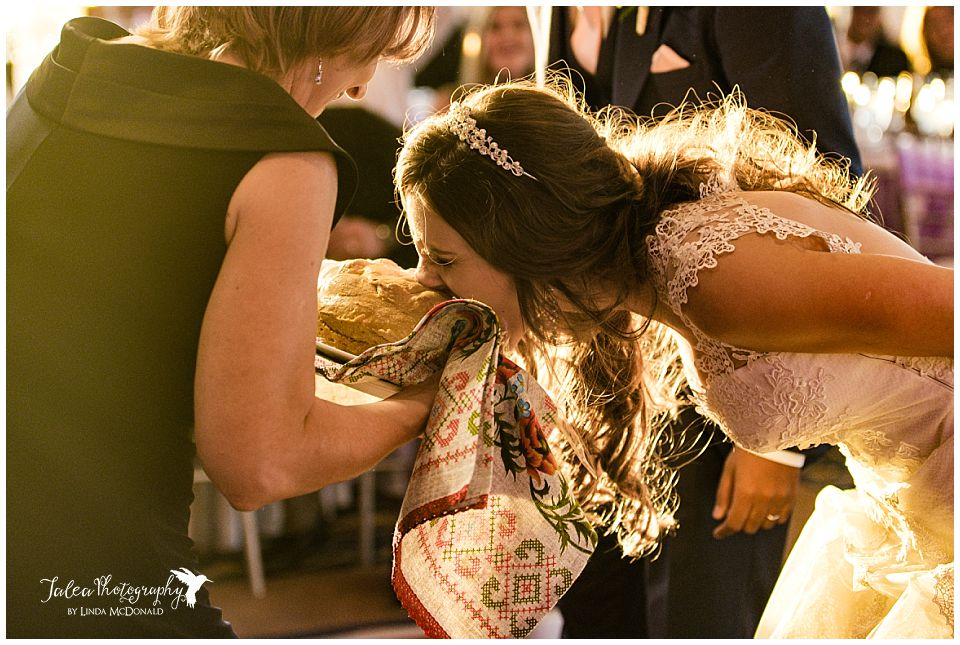 bride-accepting-bread-from-mother-russian-bread-ceremony