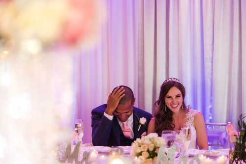 bride-and-groom-laughing-during-reception-speech