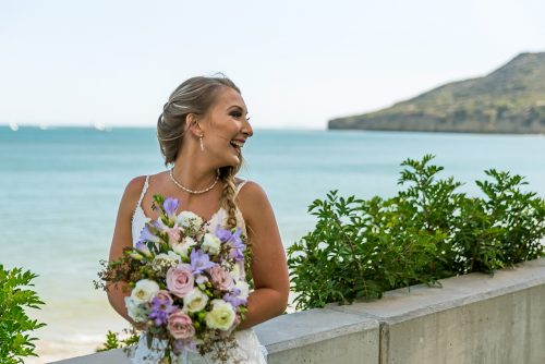 bride-laughing-by-water-at-Ballast-Point-San-Diego