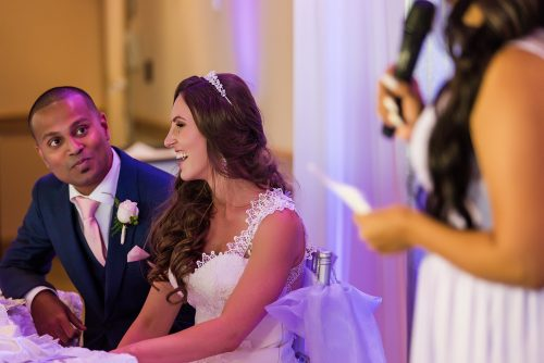 bride-looking-at-groom-laughing-from-bridesmaid-speech
