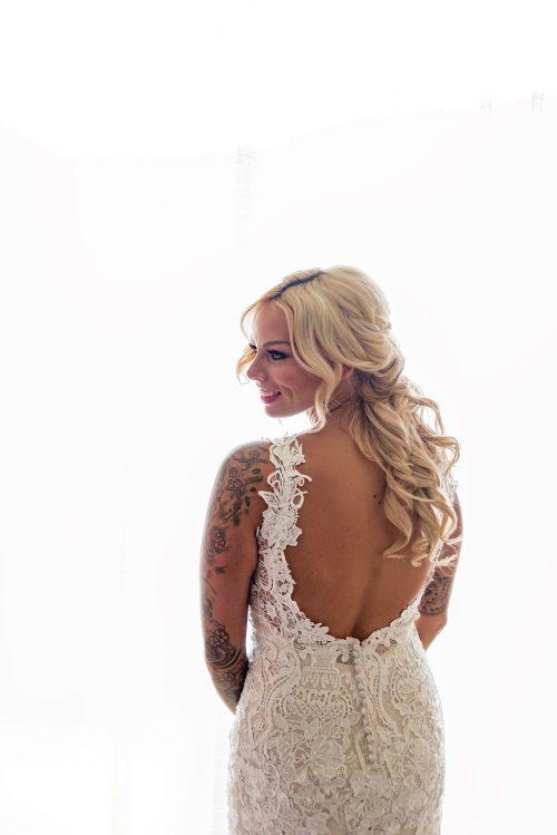 pretty-bridestanding-by-window-Jalea-Photography