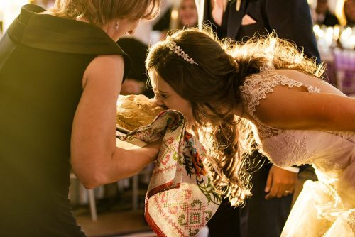 mother-offering-bread-to-bride-russian-ceremony