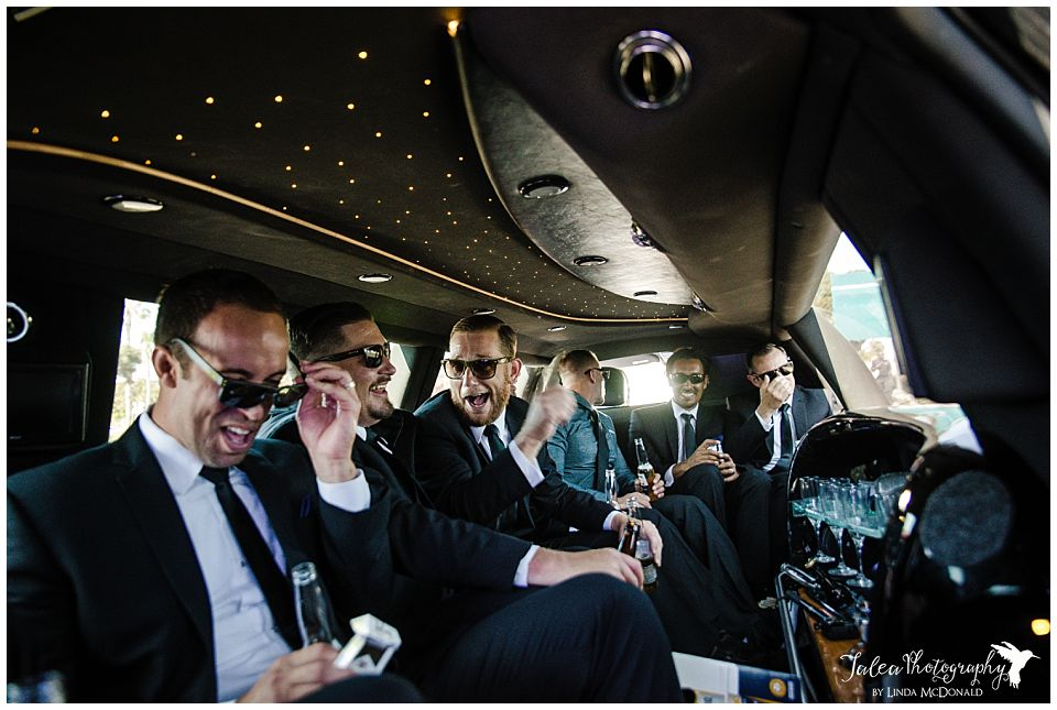groomsmen-hanging-out-in-a-limousine