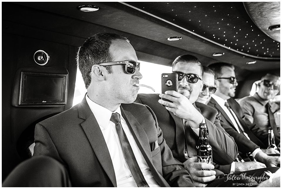 groomsmen-taking-cell-phone-pic-of-another-groomsmen-with-cigarette-hanging-from-his-mouth