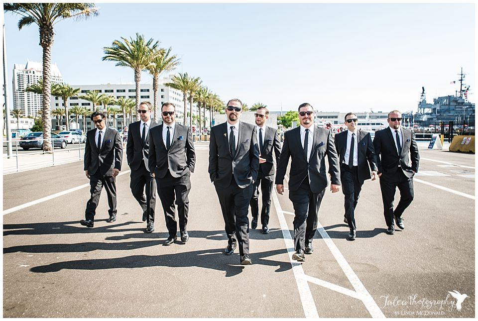 groomsmen-walking-down-street-near-san-diego-embarcadero