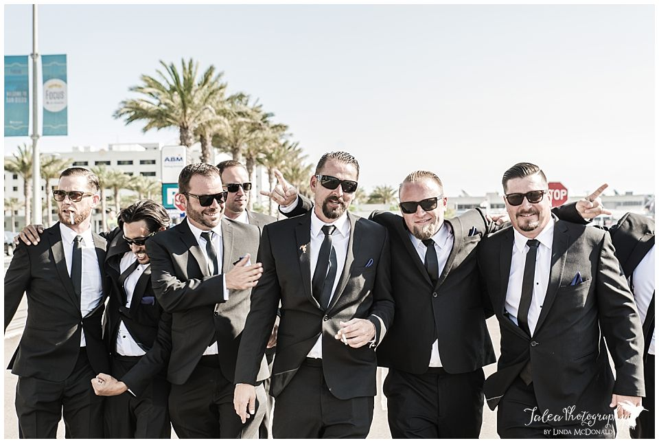 groomsmen-dressed-like-reservoir-dogs-in-a-huddle