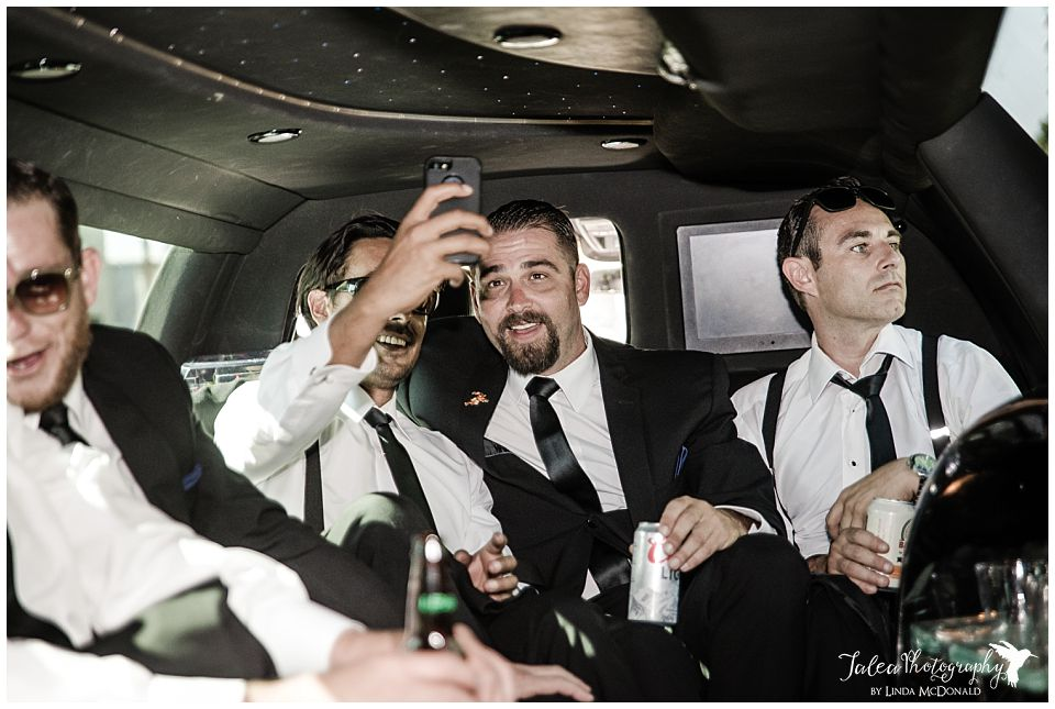 groom-groomsmen-doing-selfie-inside-limo