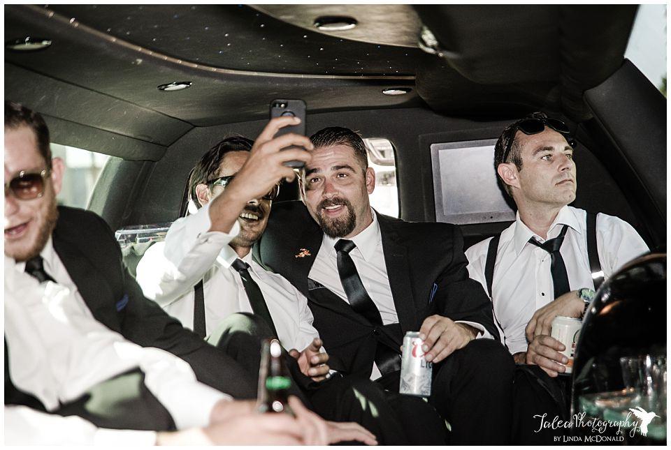 groom-groomsmen-doing-selfie-inside-limo