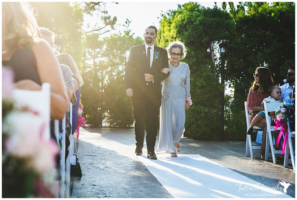 groom-walking-mother-of-the-bride-down-the-aisle