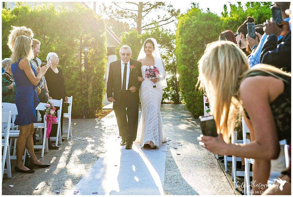bride's-dad-walking-her-down-the-aisle-at-tom-ham's-lighthouse
