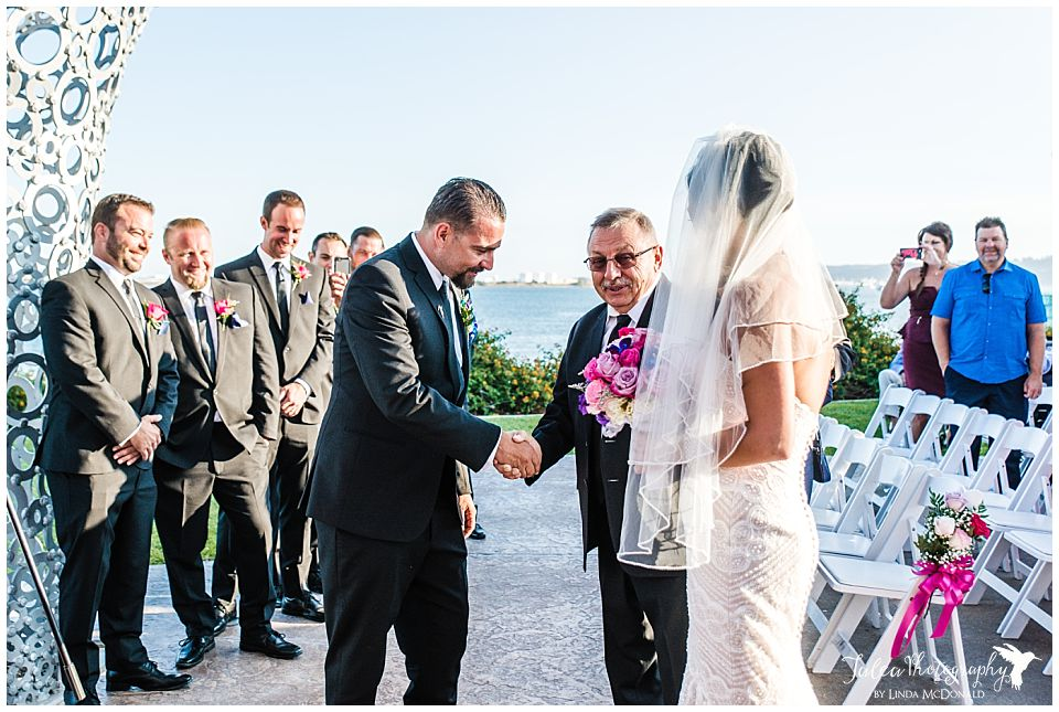 groom-shaking-father-of-the-bride's-hand-during-wedding-ceremony