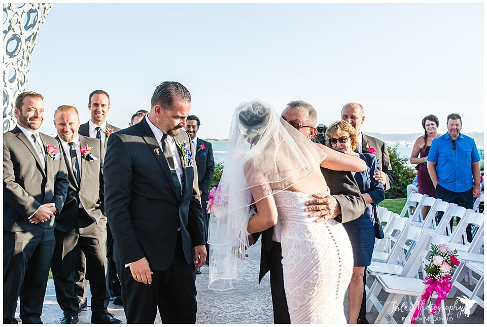 father-and-bride-hugging-before-ceremony-starts