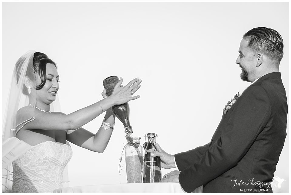 sand-ceremony-bride-groom-putting-sand-in-jar