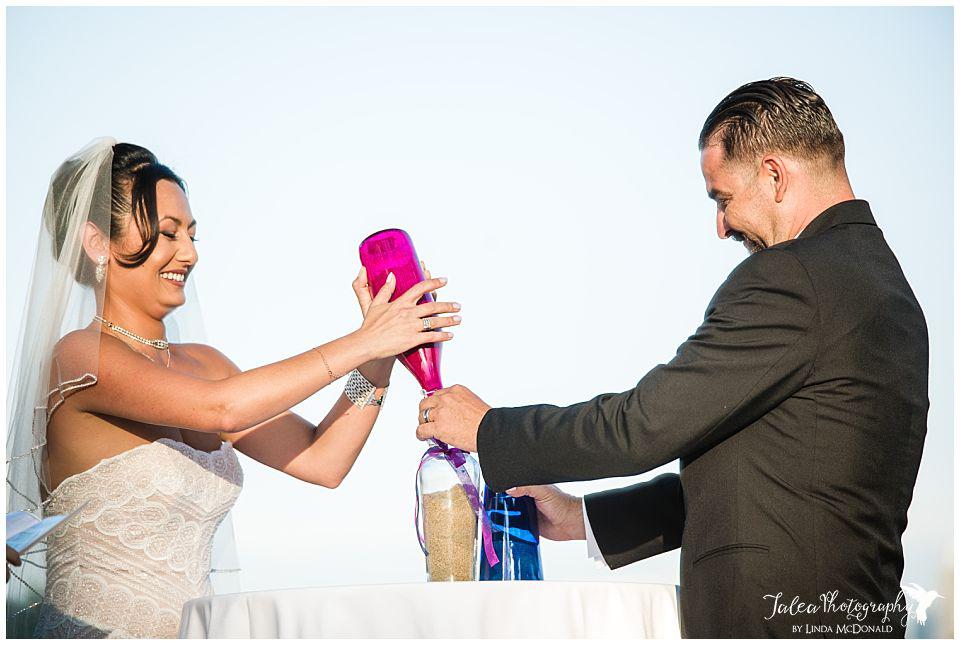 bride-groom-putting-sand-in-jar-for-sand-ceremony