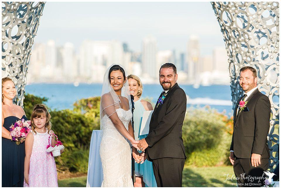 bride-groom-smiling-at-wedding-guest-tom-ham's-lighthouse-wedding