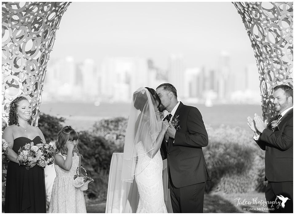 black-and-white-photo-first-kiss-tom-ham's-lighthouse-wedding