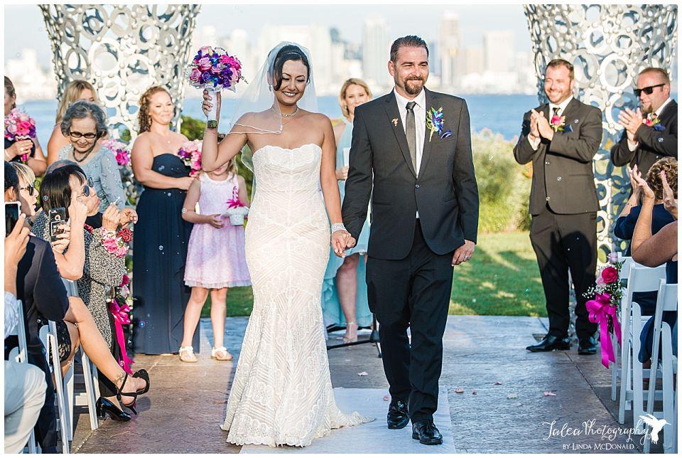 crowd-cheering-as-bride-groom-walk-down-aisle-tom-ham's-lighthouse-wedding