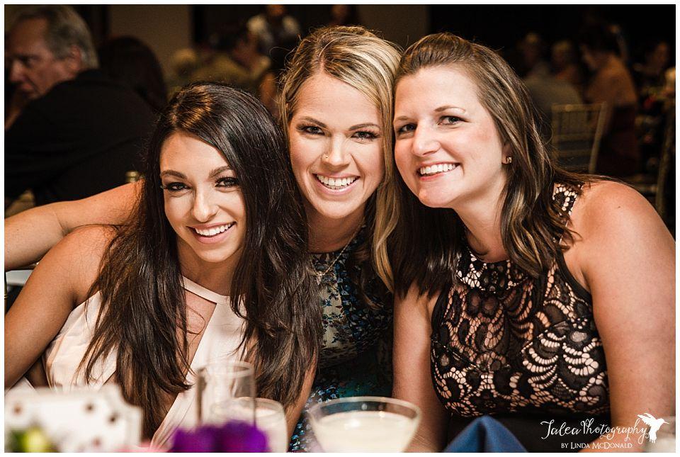 three-pretty-wedding-guest-posing-together-at-reception