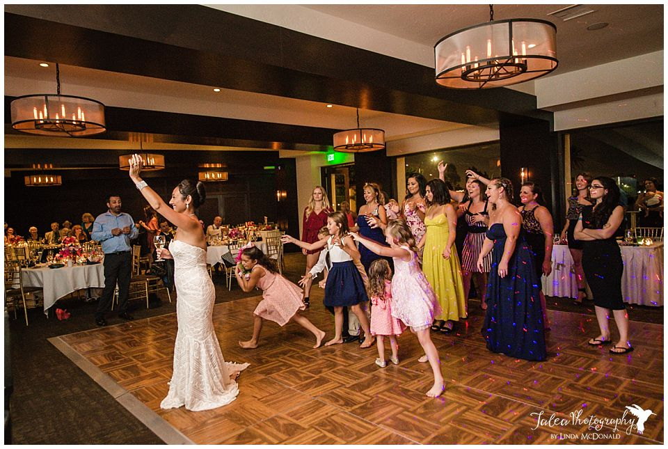 little-girl-catching-bouquet-wedding-reception