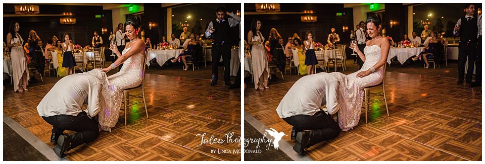bride-laughing-while-groom-is-looking-for-garter