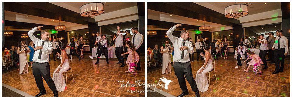 groom-tossing-garter-at-wedding-reception