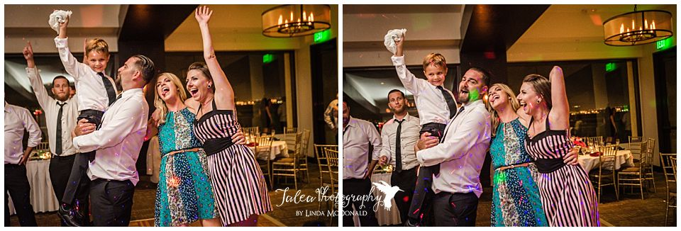 groom-holding-up-little-boy-who-caught-garter