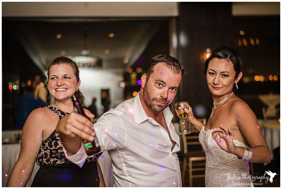 bride-dancing-with-guest-at-wedding-reception-tom-ham's-lighthouse