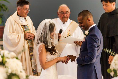 wedding-bride-placing-ring-on-grooms-finger