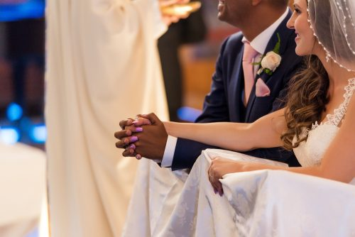 wedding-ceremony-bride-groom-holding-hands-st-columba-church-san-diego