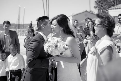 bride-leading-groom-on-grassy-hill-at-twin-oaks-golfcourse
