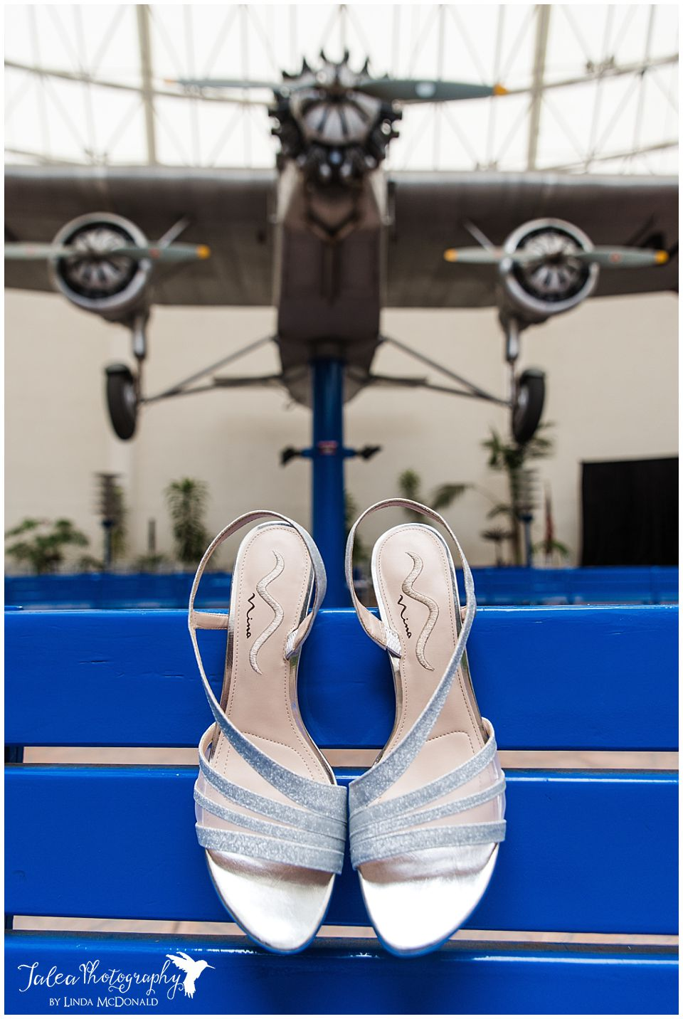 bride's wedding shoes in front of airplane