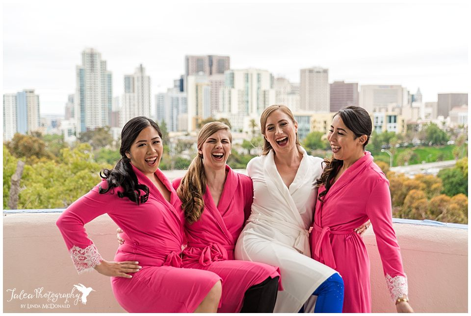 bride bridesmaids pink robes laughing having fun