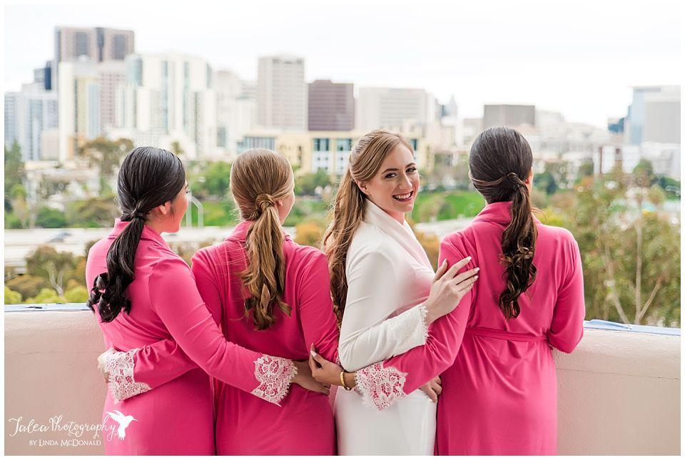 bride in robe looking back san diego air space museum wedding
