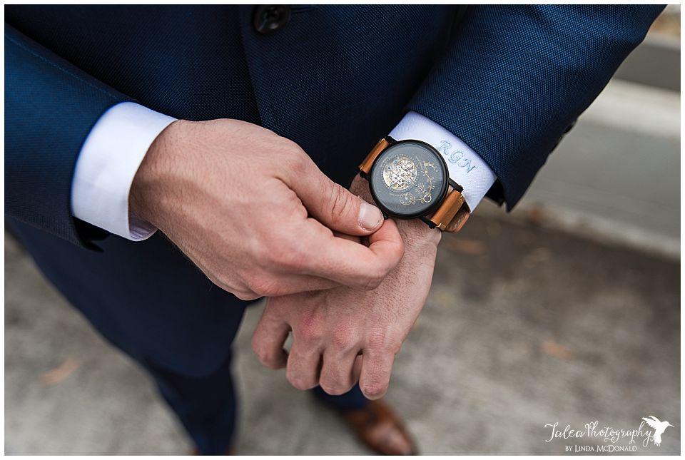groom adjusting his watch