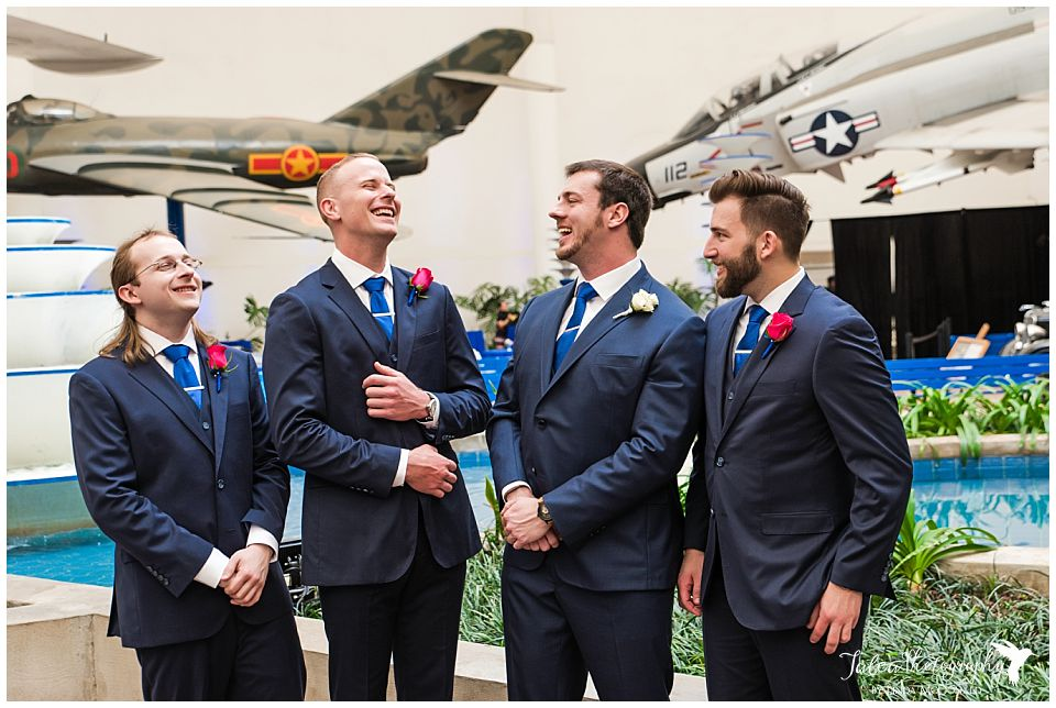 groomsmen laughing together san diego air space museum wedding photos